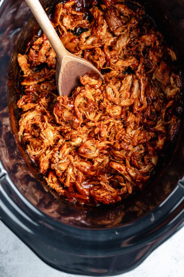 pulled chicken cooking in a slow cooker