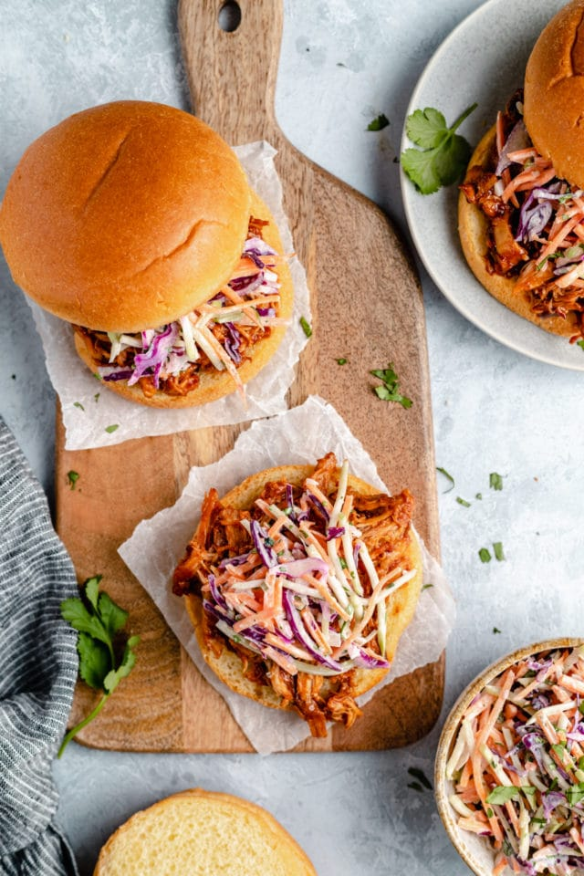 slow cooker pulled chicken on a bun with coleslaw