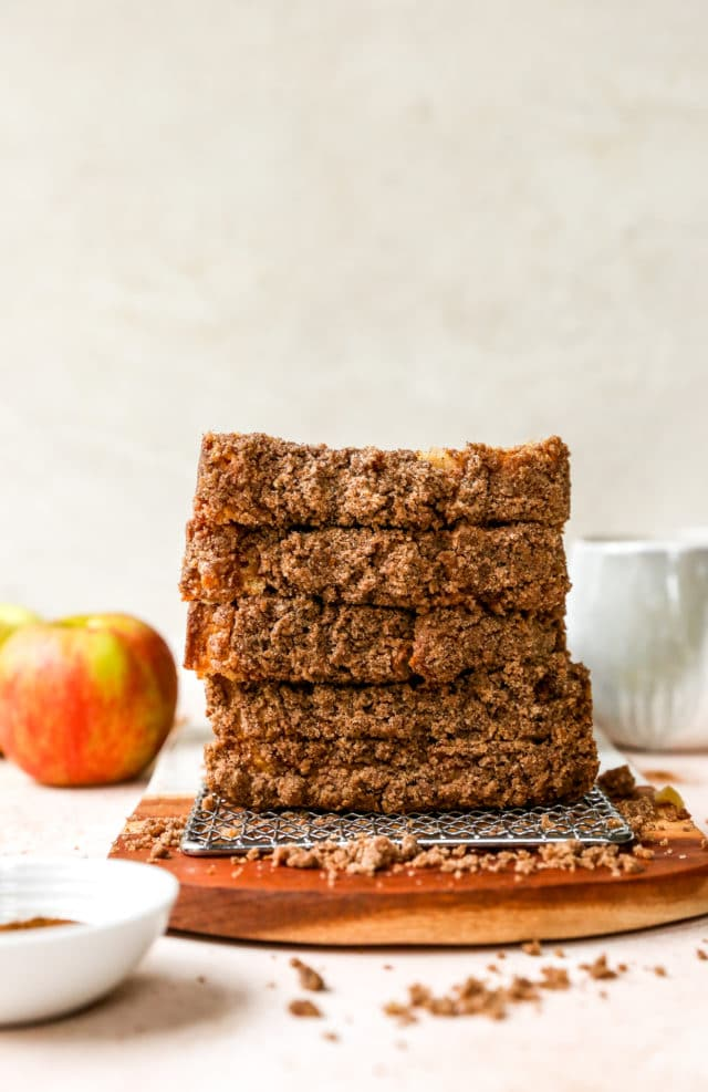slices of apple streusel bread stacked on top of each other