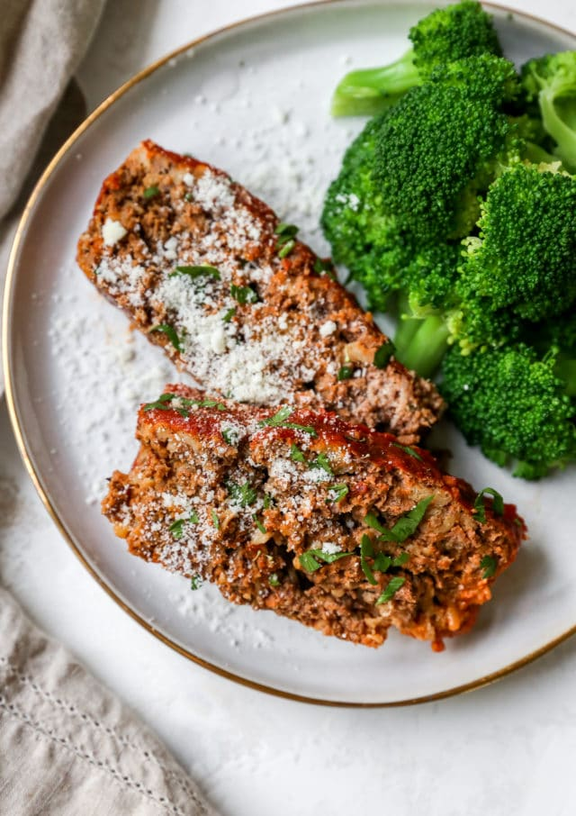 slices of an easy meatloaf recipe served with broccoli