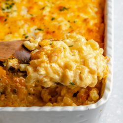 wooden spoon dishing out mac and cheese