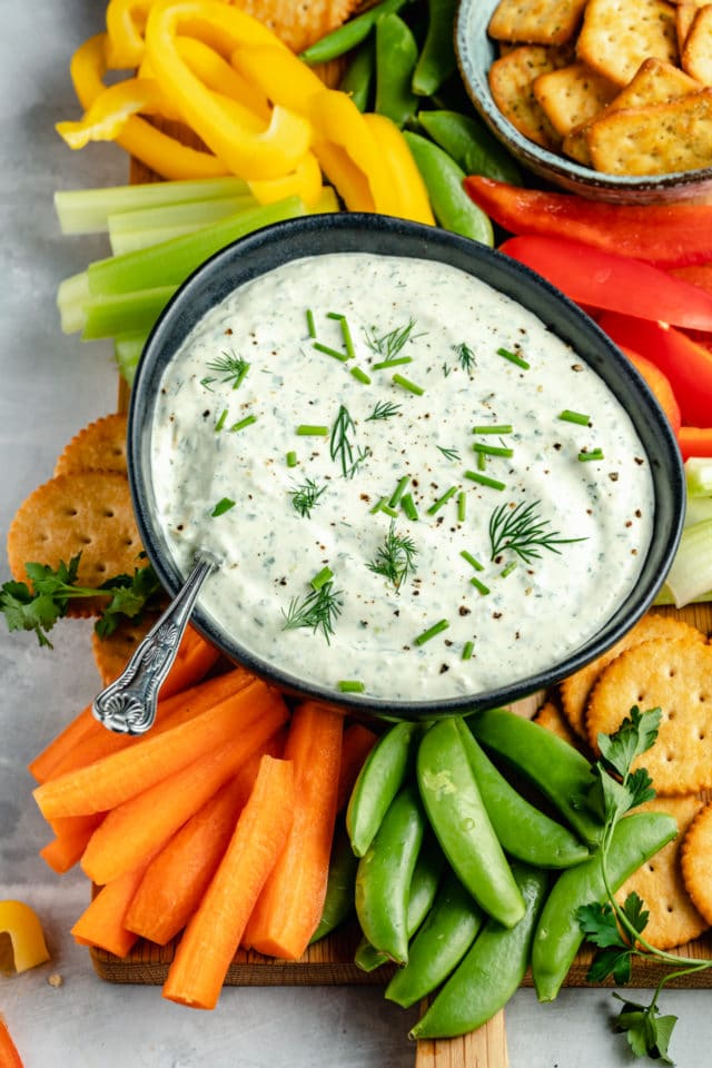 fresh herb cream cheese dip served with raw veggies and crackers