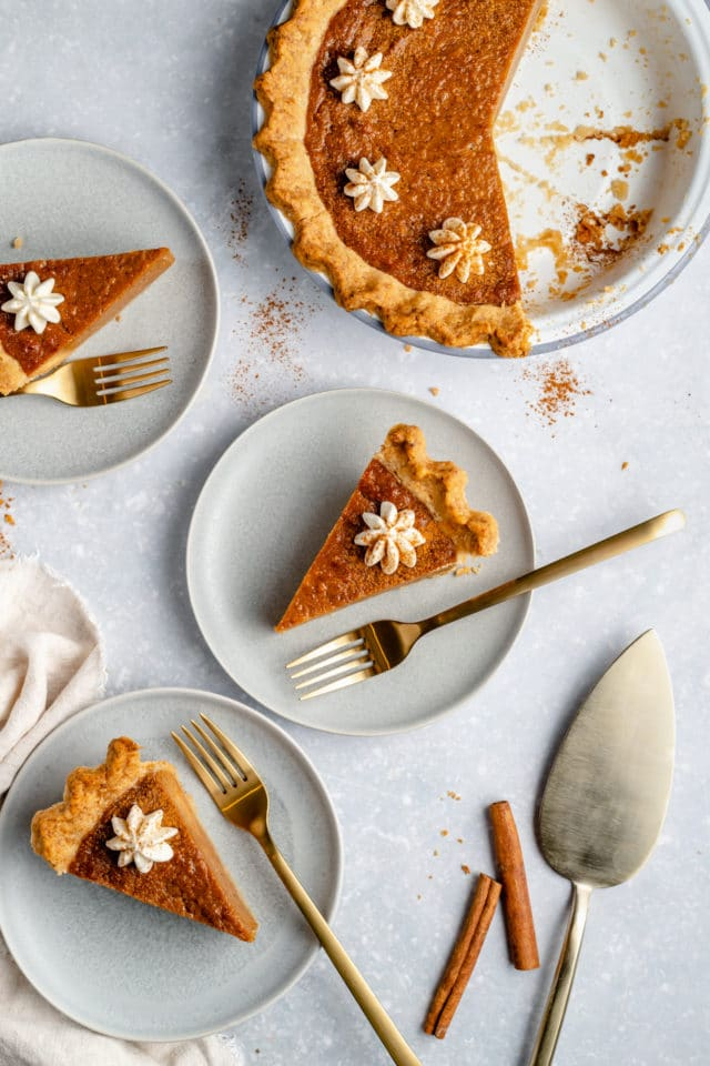 sweet potato pie sliced and served on white plates
