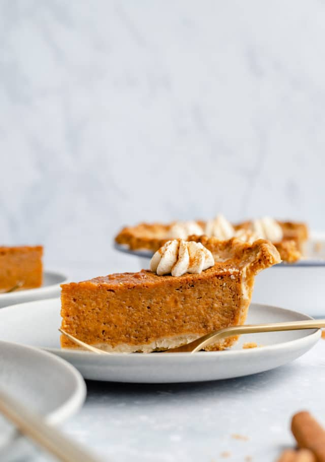 slice of sweet potato pie served on a small plate with a fork