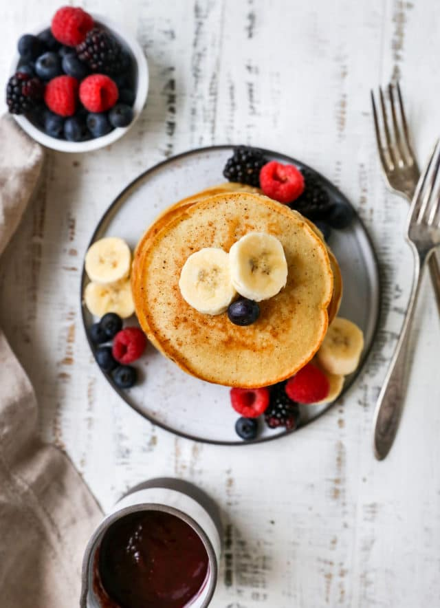 pancakes topped with banana slices and berries