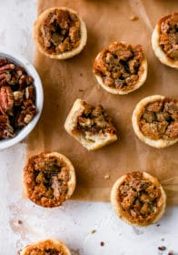 mini pecan pies on parchment paper
