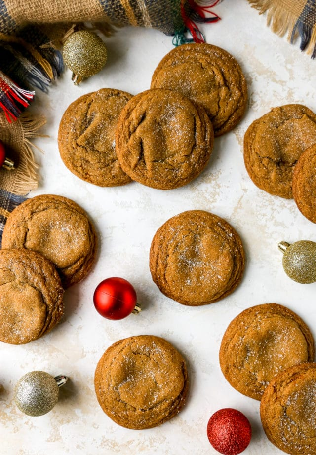 molasses cookies topped with sugar near Christmas balls
