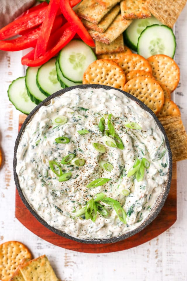 spinach dip served with crackers and veggies
