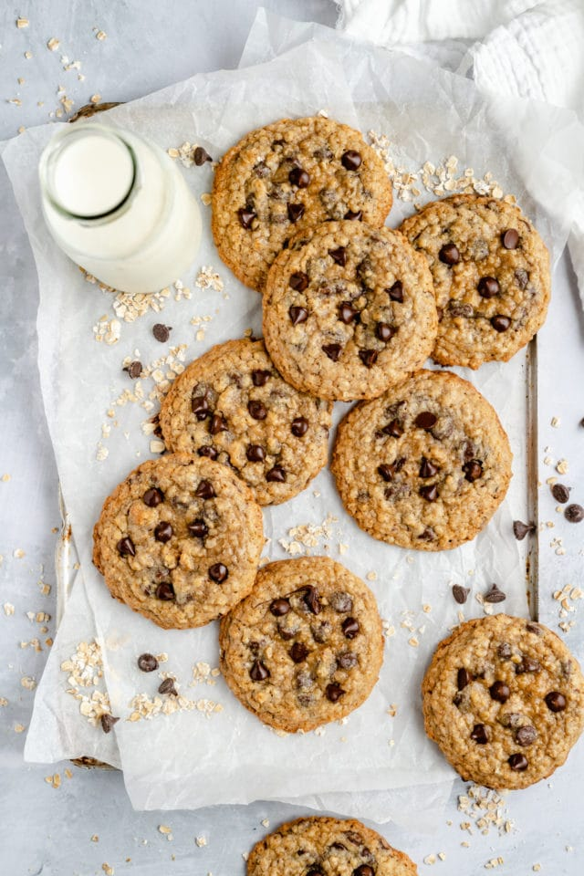chewy chocolate chip oatmeal cookies on parchment paper