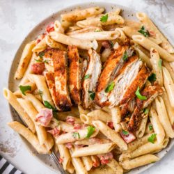 creamy chicken pasta served on a plate with a fork
