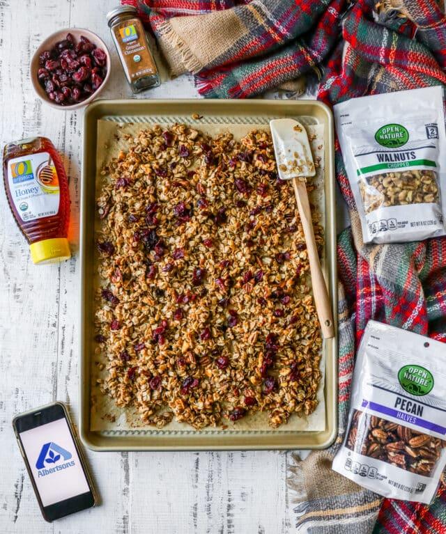 granola on a baking sheet near ingredients