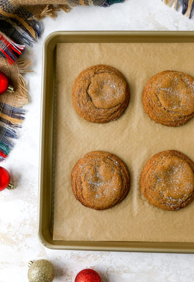 baked cookies on a baking sheet pan lined with parchment paper