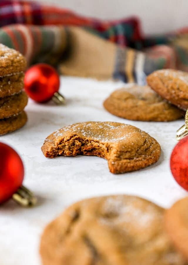 bitten into molasses cookie near red ornament balls