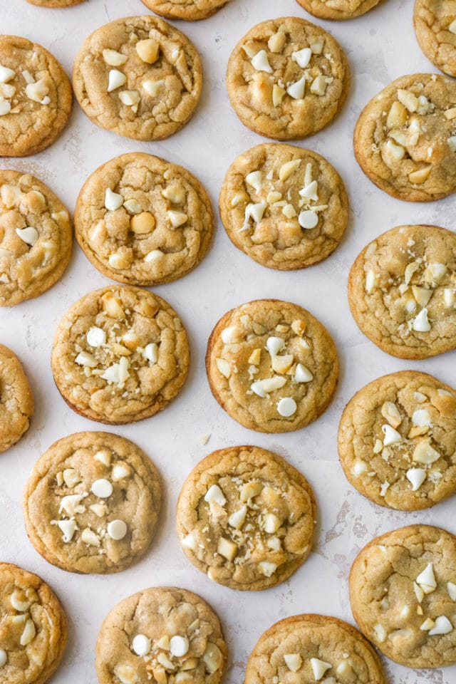 white chocolate macadamia nut cookies on a marble counter