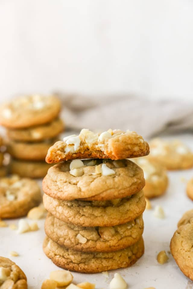 stacked cookies with a bite out of the top one