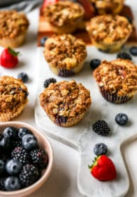 baked berry muffins served with fresh berries