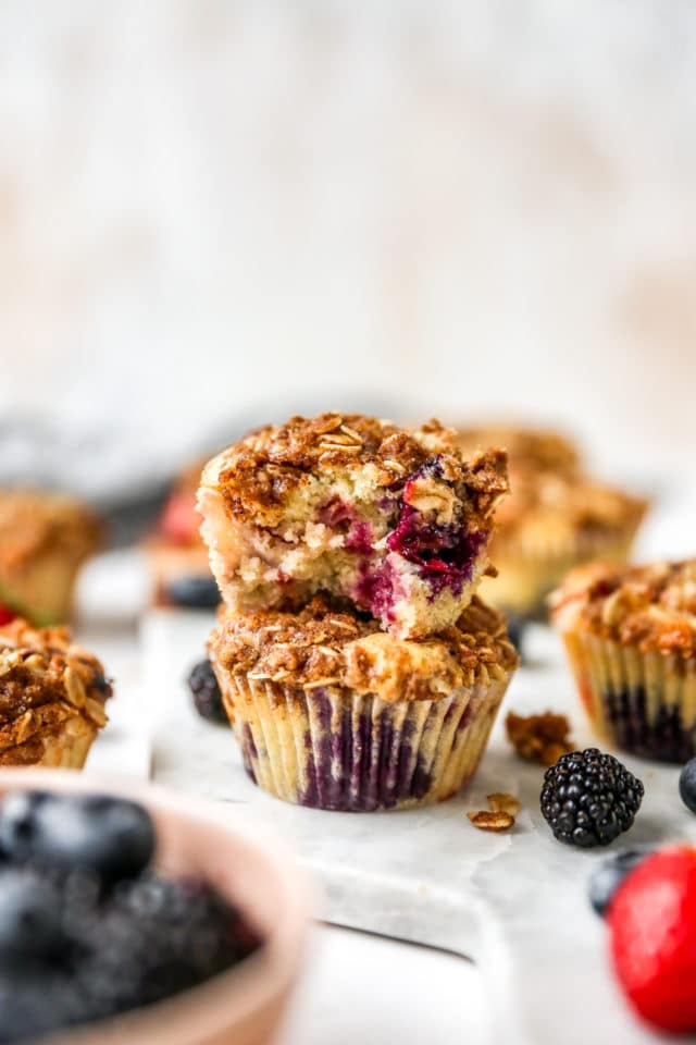 two stacked mixed berry muffins