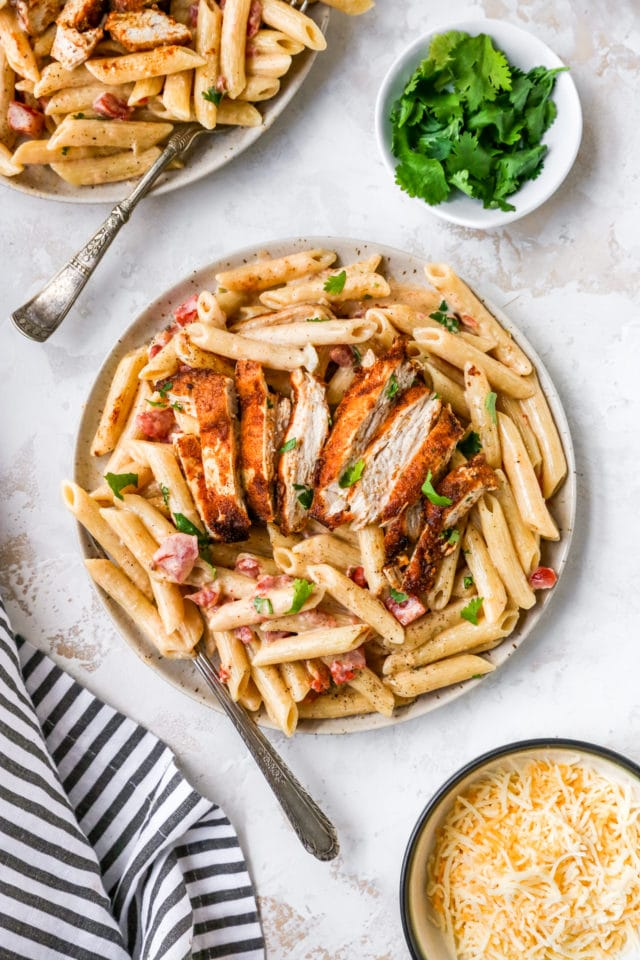 creamy chicken pasta topped with fresh parsley