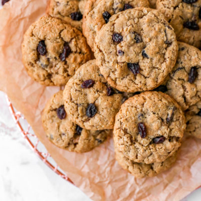 Best Oatmeal Raisin Cookies stacked on parchment paper