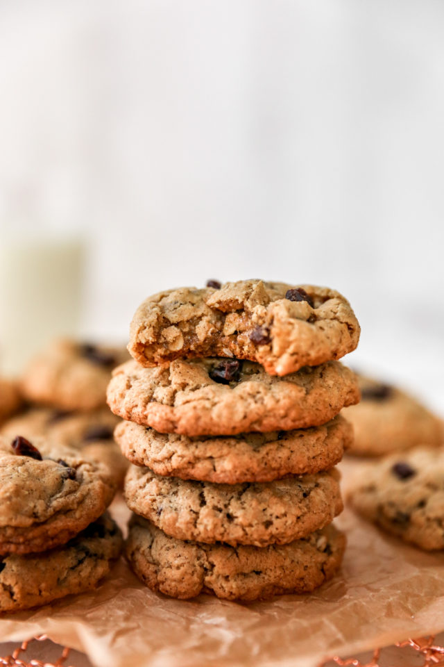 a stack of oatmeal raisin cookies with a bite out of one