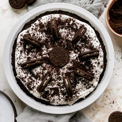 oreo pie with a cool whip filling topped with crushed Oreos