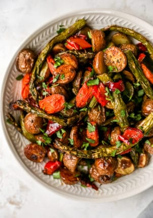 roasted vegetables in a large white serving bowl