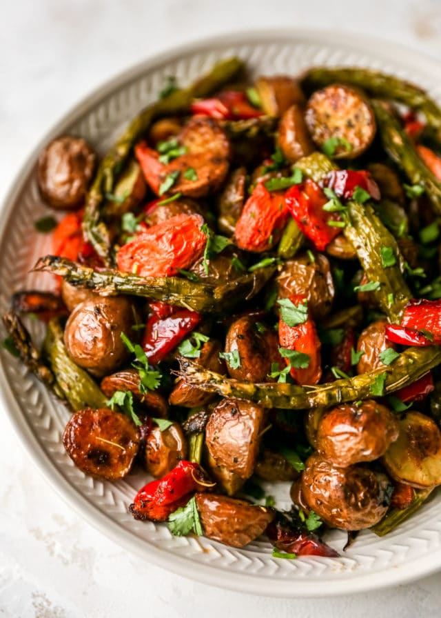 roasted potatoes, bell pepper, asparagus and carrots in a bowl