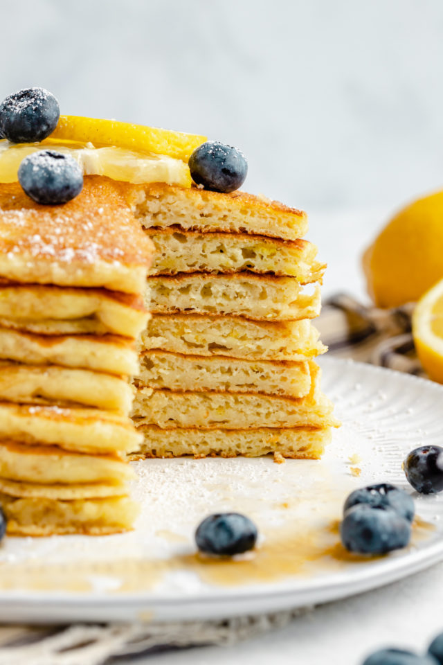 large stack of lemon ricotta pancakes that have been cut into