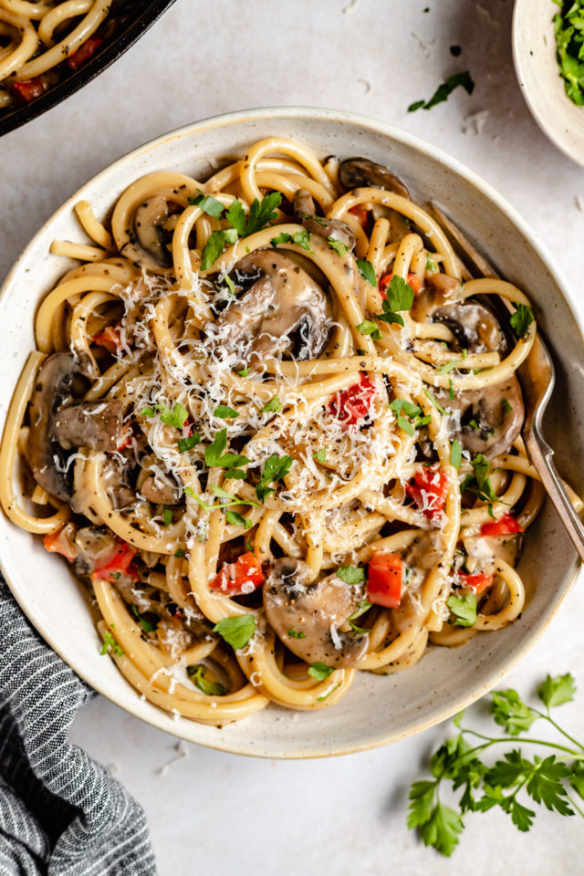 spaghetti with mushroom sauce and topped with Parmesan cheese