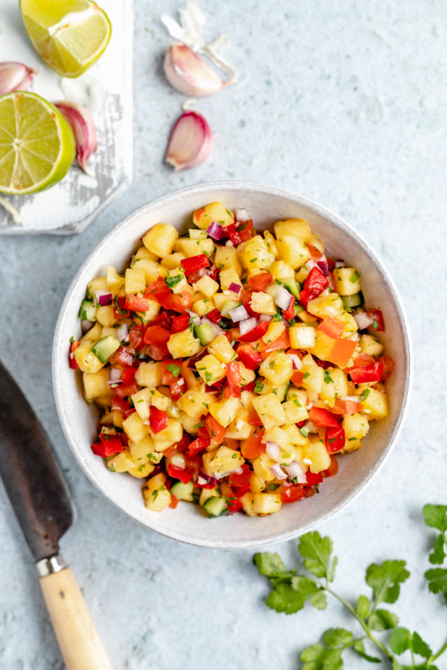 pineapple cucumber salsa in a white bowl