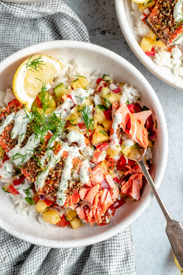 salmon bowls that include rice, pineapple salsa and dill sauce