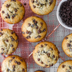chocolate chip banana muffins on a wire cooling rack