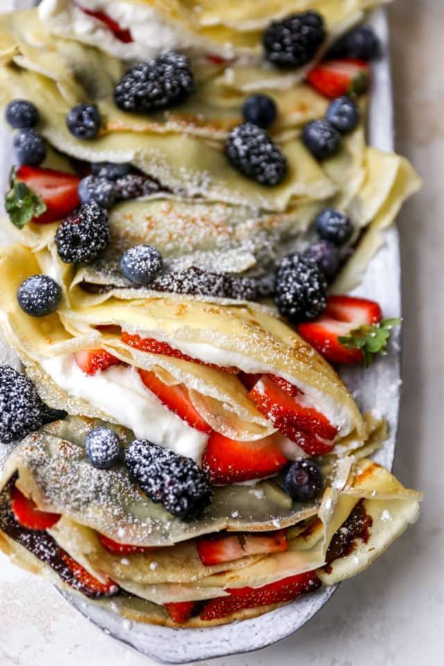 homemade crepe recipe stuffed with homemade whipped cream and berries