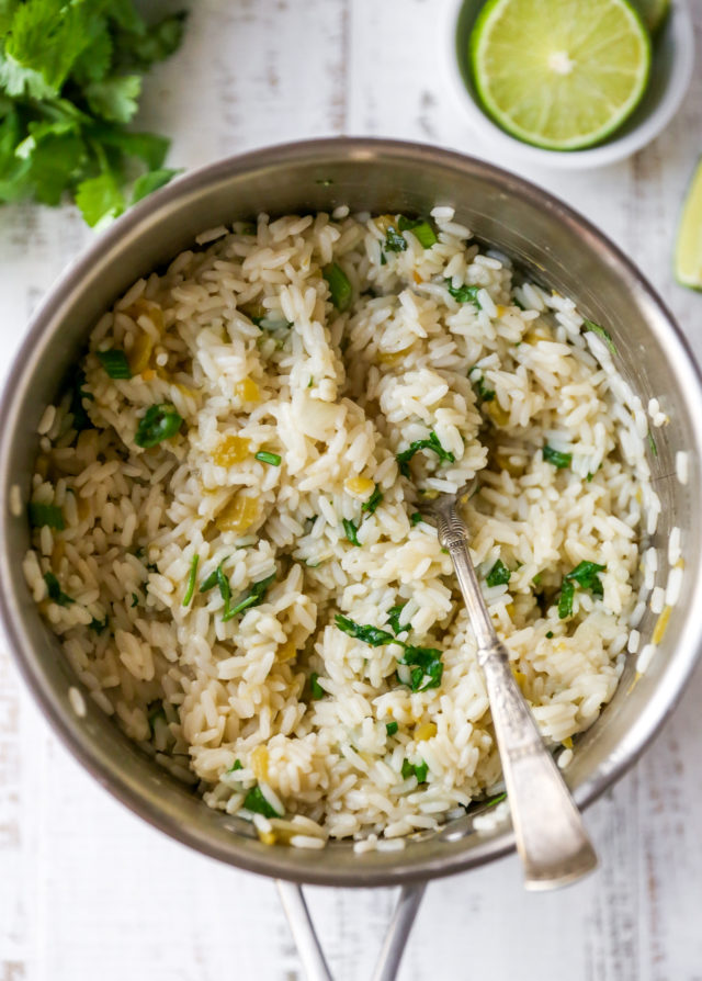 stirring rice with cilantro and green onions