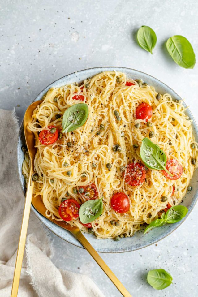 tossed lemon pasta in a large serving bowl