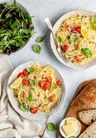 lemon pasta topped with cherry tomatoes and fresh basil