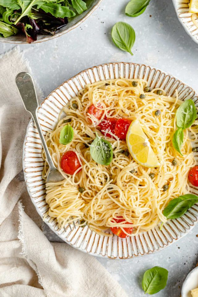 lemon pasta in a bowl and twirled around a fork