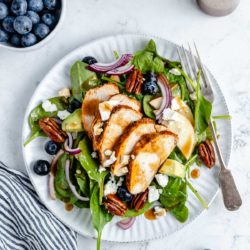 spinach salad topped with chicken