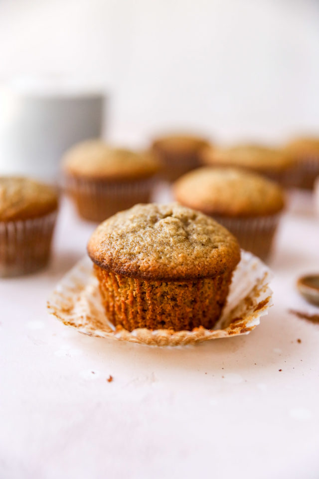 unwrapped banana muffin near other muffins