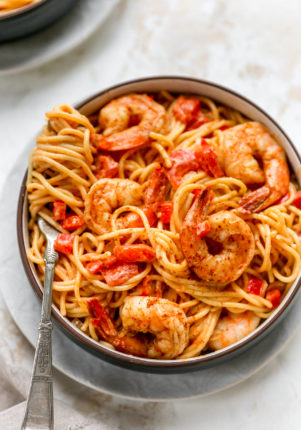 Creamy Cajun Shrimp Pasta in a bowl with pasta swirled around a fork