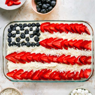 flag cake decorated with strawberries and blueberries