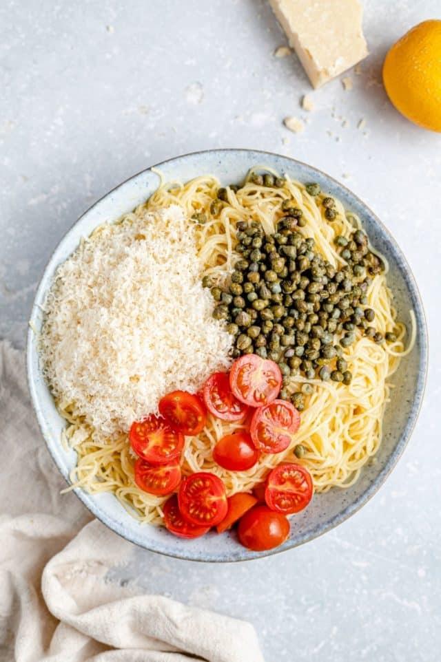 lemon pasta ingredientsin a large white bowl