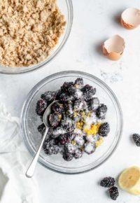 combining blackberries with lemon zest and sugar