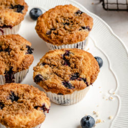 Blueberry Crumb Muffins on a large white serving plate