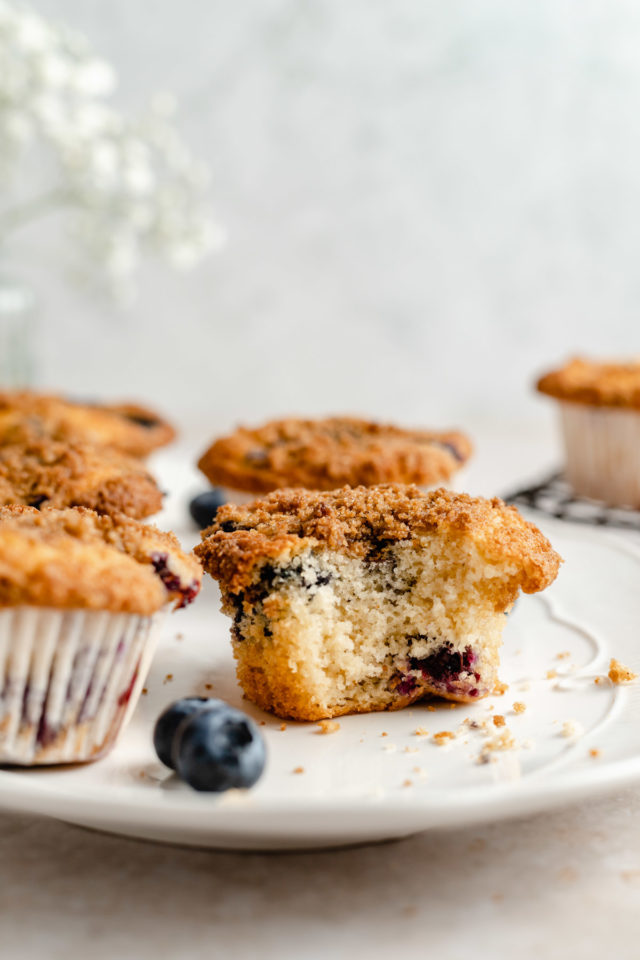 blueberry crumb muffin with a bite taken out