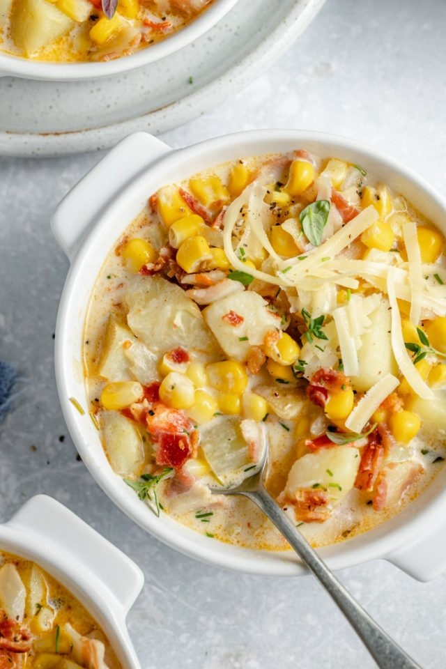corn and potato chowder topped with bacon bits and fresh thyme