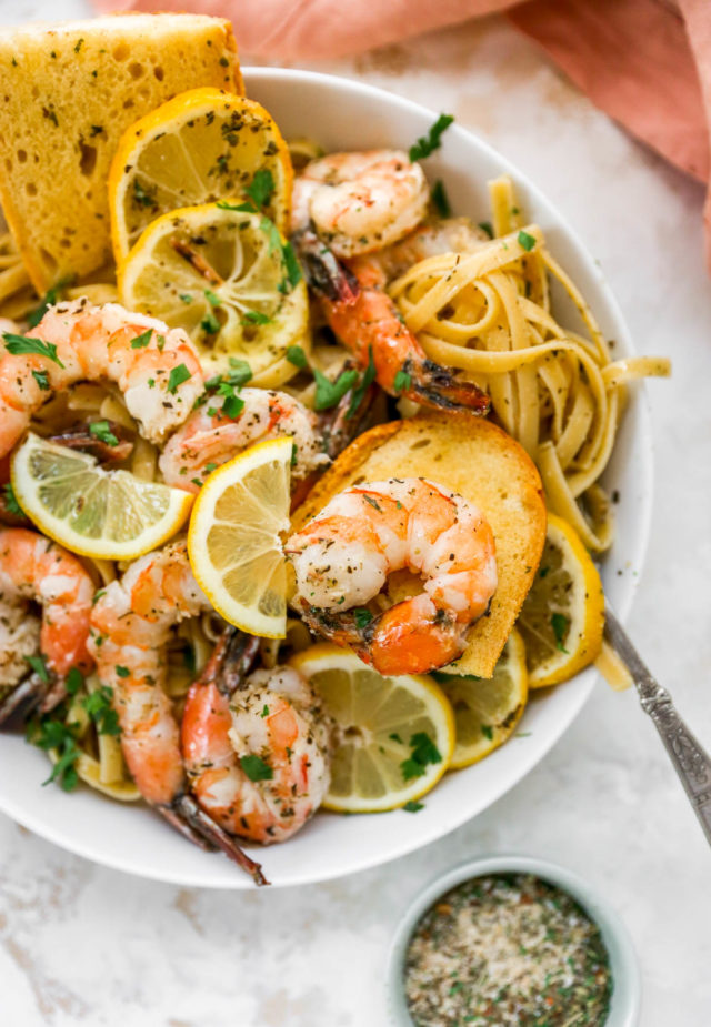 baked shrimp served with pasta and garlic bread