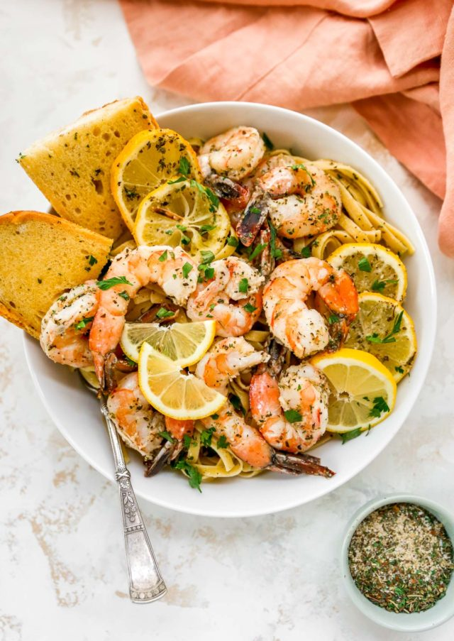 bowl of pasta topped with shrimp