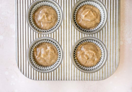 fill muffin pan with banana muffins batter