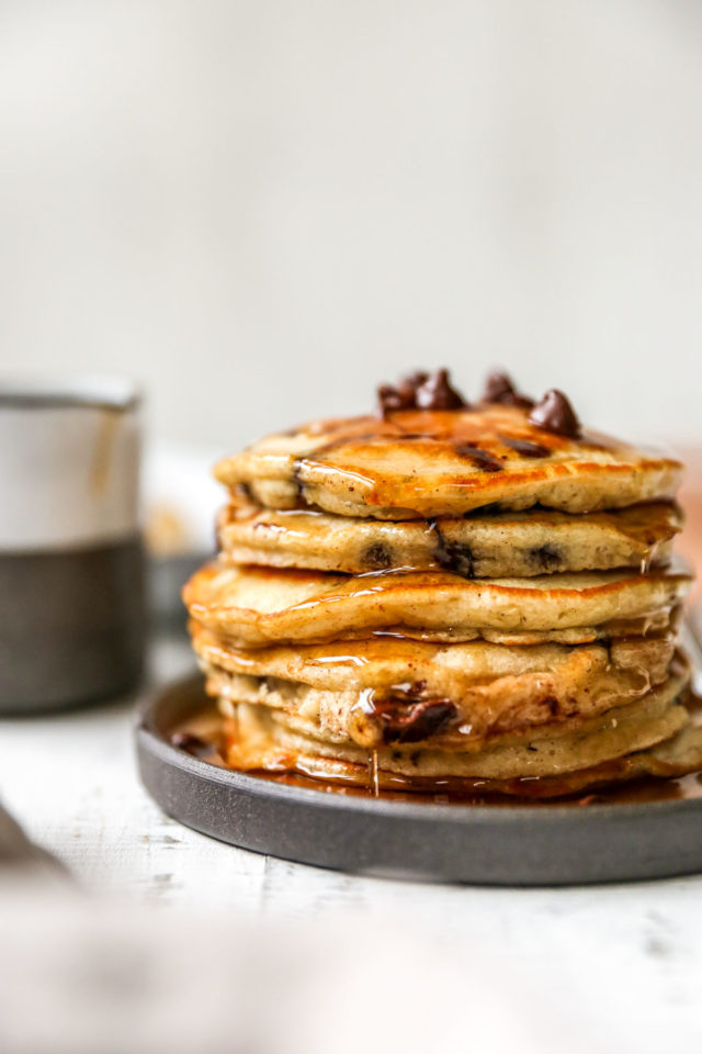 pancakes stacked on a plate and topped with chocolate chips